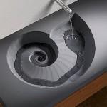 Ammoniittifossiilin muotoinen betoninen pesuallas