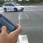iPhonea käytetään ohjaamaan autoa