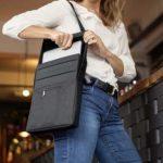 LAER-laptop-laukku pitää sisällään virtalähteen erilaisten laitteiden latausta varten