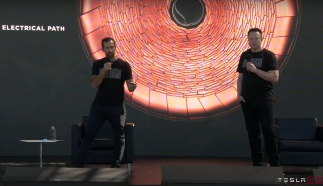 Elon Musk and Drew Baglino present in front of a slide showing Tesla's new 'tabless' cell design.